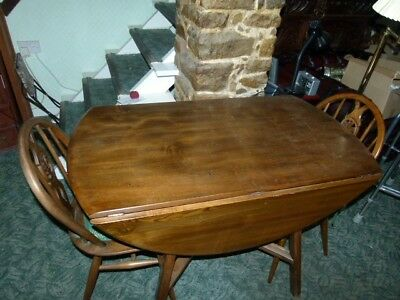 Vintage solid oak round drop leaf table with 4 chairs