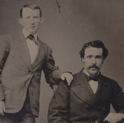 Portrait Of Two Affectionate Young Men W/ Posing Stand