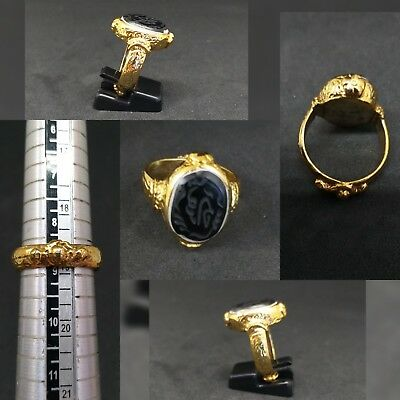 Gold gilded old ring with beautiful Islamic writing black agate stone