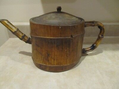 Tea pot pitcher kettle teapot with a lid made of carved bamboo wood
