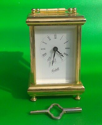 Rudell Brass Carriage Clock - Working order with key - Missing a foot