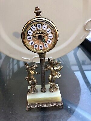 antique clocks ESTYMA ALARM WITH GILT DECORATION