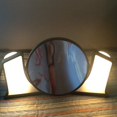 Lovely vintage light up mirror by Regent of London