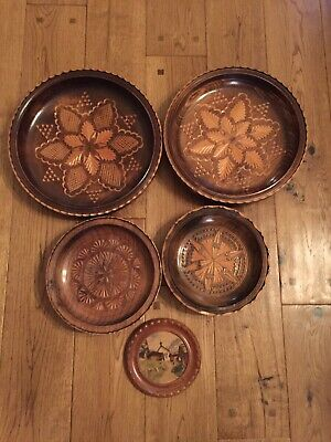 Selection Of Vintage Wooden Wall Plates Bowls Picture