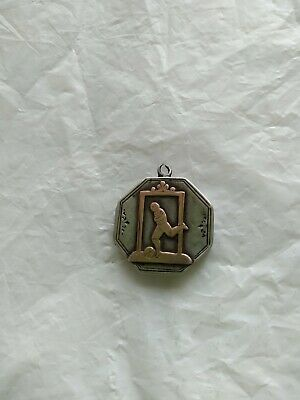Antique Silver locket with Footballer in Gold on front