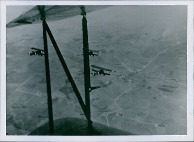 Aerial view of flying aircraft in air during war in Norway. - 8x10 photo