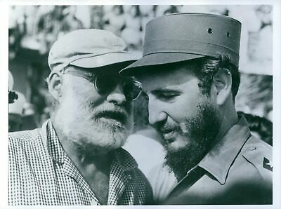 Ernest Hemingway and Fidel Castro having discussion with each other. - 8x10 phot