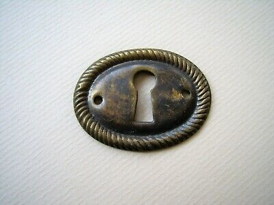 Decorative antique oval stamped brass cabinet keyhole escutcheon (CE5)