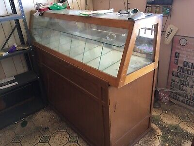 vintage display cases dating ti 1950's separate pieces one with glass case.