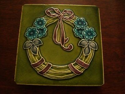 Art Nouveau Relief Moulded & Tubelined Flowers with purple ribbon Tile  19/54