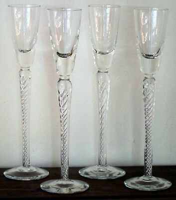 Set of 4 stemmed liquor / champagne glasses with enclosed swirls in the stems
