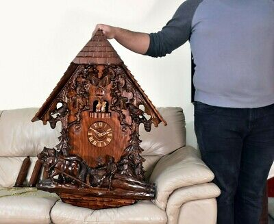 Massive Black Forest Cuckoo Clock heavily carved 8 day mechanical chalet music