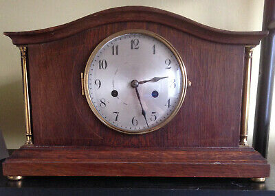 Vintage Chiming Mantel Clock With Brass Collannades To The Front.