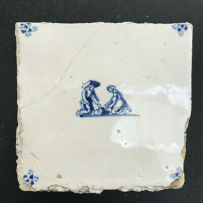 17th Century DUTCH DELFT TILE WITH TWO BOYS KNEELING BY A HAT