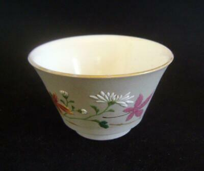 Fine Antique Japanese Banko Ware Tea Bowl with enamel flowers: Early C.20th