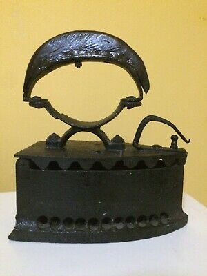 Vintage old antique cast coal iron with wooden handle