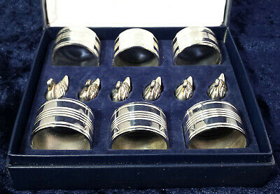 Lovely boxed set 6 vintage silver plated napkin rings & swan place card holders