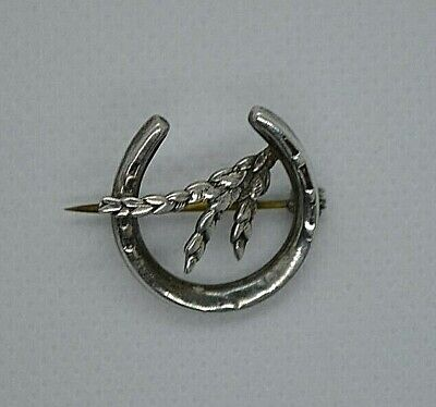 Vintage or antique small sterling silver lucky heather horse shoe brooch