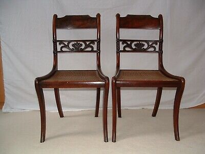 regency period. pair of original mahogany sabre legged chairs, with cane seats