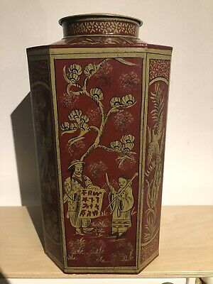 A Tall Octagonal Chinese Design Toleware Red Tea Tin And Cover
