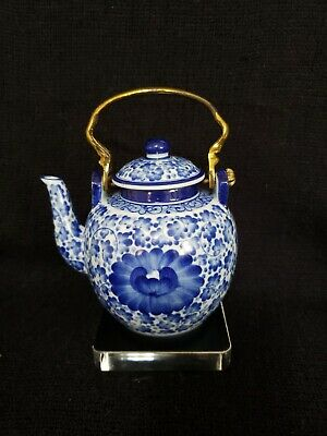 Small Round Vintage Blue and White Floral Teapot with Brass Handle