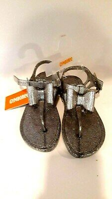95d2414302e0 Gymboree Girls Size 13/1 Silver Glitter Jelly Sandals With Bow Buckle Strap