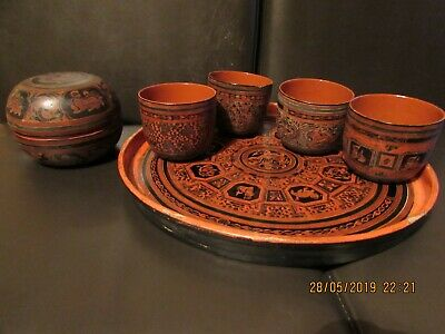 Burmese red and black lacquer tray cups and graduated stacking bowls