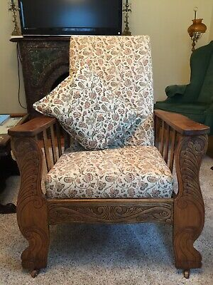 Antique Carved Wooden Recliner on wooden rollers. Upholstered with pillow.