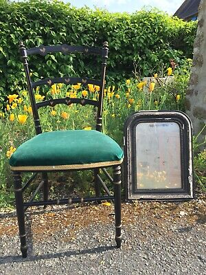 French Antique ebonised Napoleon III style chair with gilded decoration.