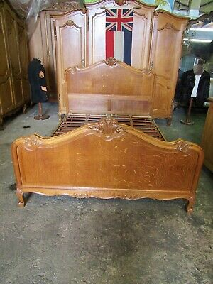 Handsome vintage French king size carved oak bed with good slatted base.Louis xv