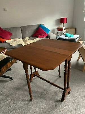 Antique Walnut Victorian Drop Leaf Table.