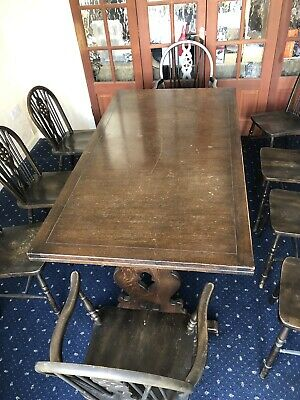 A 20th Century Solid Dark Oak Extending Dining Table