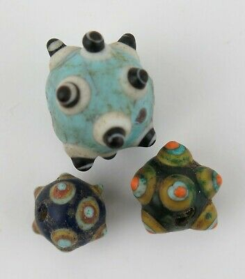 Trio of Chinese 'horned eye' trade beads