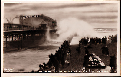 Real Photo Postcard of Brighton Pier in Sussex with Big Waves UK B84