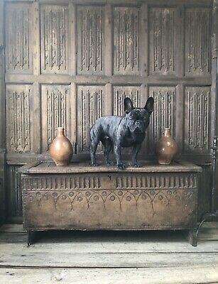 A 17th Century Carved Oak Six Plank Coffer