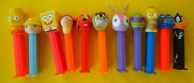 11 x  MIXED PEZ DISPENSERS IN GOOD CONDITION DATES UNKNOWN FREE TRACKING POSTAGE