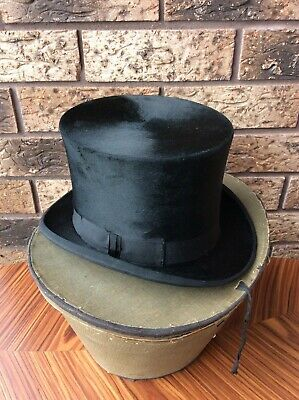 Antique fur black top hat and original transport case