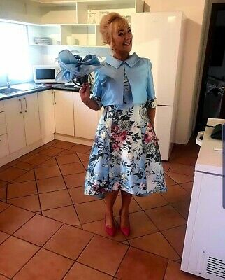 mother of the bride. Dress, jacket and head piece