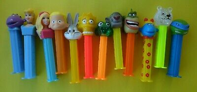12 x  MIXED PEZ DISPENSERS IN GOOD CONDITION DATES UNKNOWN FREE TRACKING POSTAGE