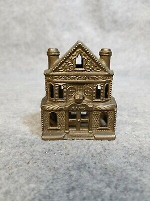 Antique Metal House Bank, 3 1/4 inches tall.