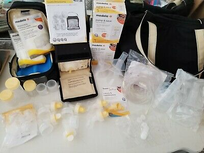 Medela Breast Pump In Style Advanced Breastfeeding Lot, ALOT of EXTRA PARTS