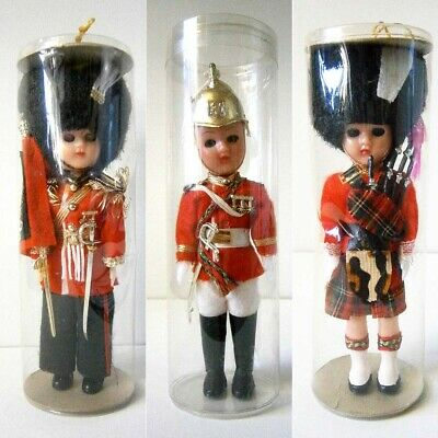 3x VINTAGE HARD PLASTIC COSTUME DOLLS QUEENS GUARDS in CYLINDERS