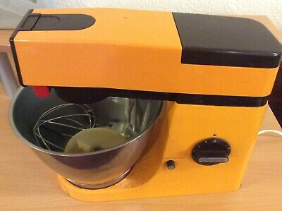 Vintage tangerine coloured Kenwood Chef with tools