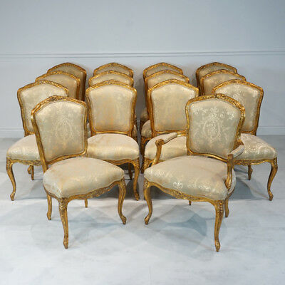 Stunning Set of 14 Louis XV French mahogany dining chairs with gold leaf
