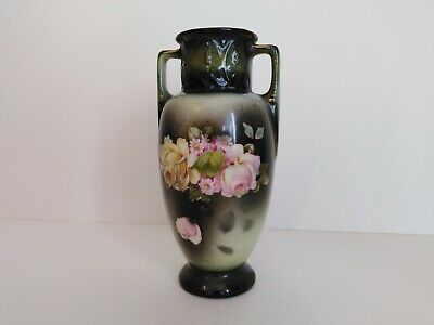 Vintage double handled ceramic vase in olive green with pink & yellow roses.