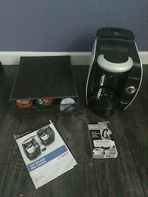 Bosch tassimo coffee maker with cup holder and 46 cups plus descaler