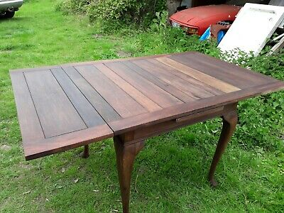Antique solid oak dining table with two additional leaves