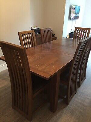 Extending Wooden dining table and 6 chairs