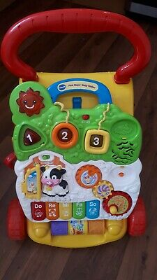 VTech Baby Walker farm theme in good condition with detachable play center.