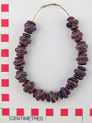 Fifteen blue red & white striped glass collared vase trade beads.